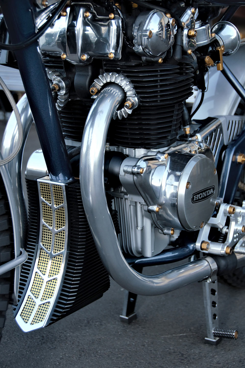 """""""The project's inspiration was taken from the design of the Honda Dream bikes from the 50s and 60s. """"The square headlight bucket housing the speedometer and ..."""